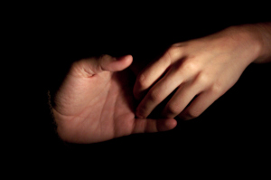 Picture of a hand reaching out to help a friend